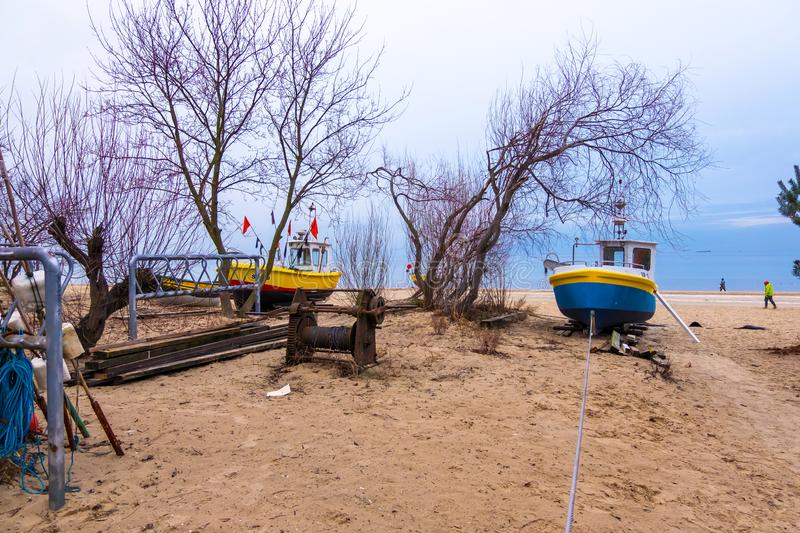 Fishing boats on the sandy beach at the Baltic Sea coast in Sopot, Poland stock images