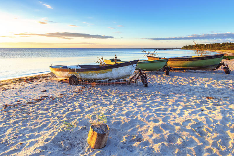Fishing boats at a sandy beach of the Baltic Sea stock images