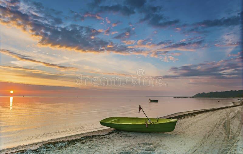 Fishing boats at a sandy beach of the Riga gulf. Latvia royalty free stock photo