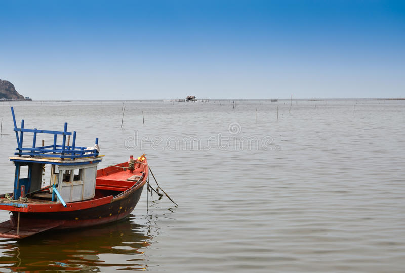 Fishing boats in the sea. Sky background royalty free stock image