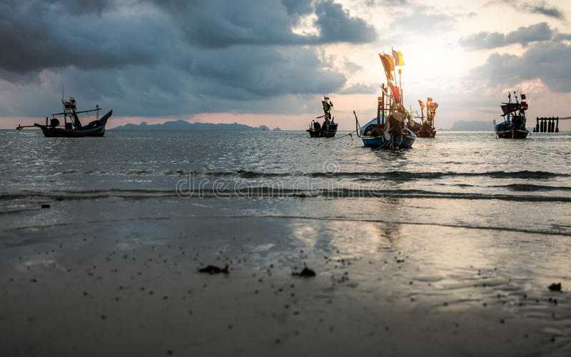 Fishing boats on the sea during sunset royalty free stock photo