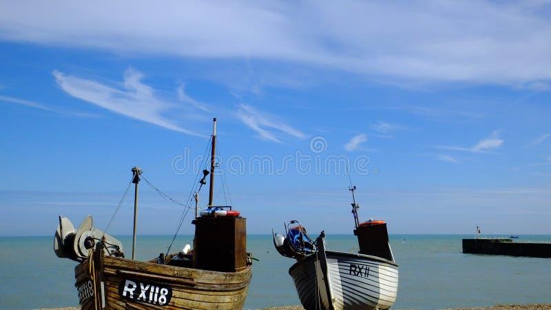 Fishing boats on seacoast royalty free stock photography