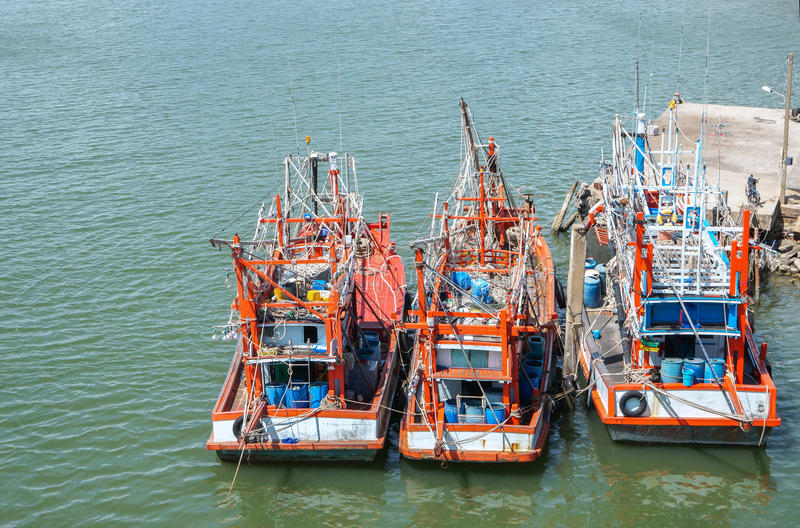 Fishing boats stand in the harbor To transport fish from the boat to the market royalty free stock photos