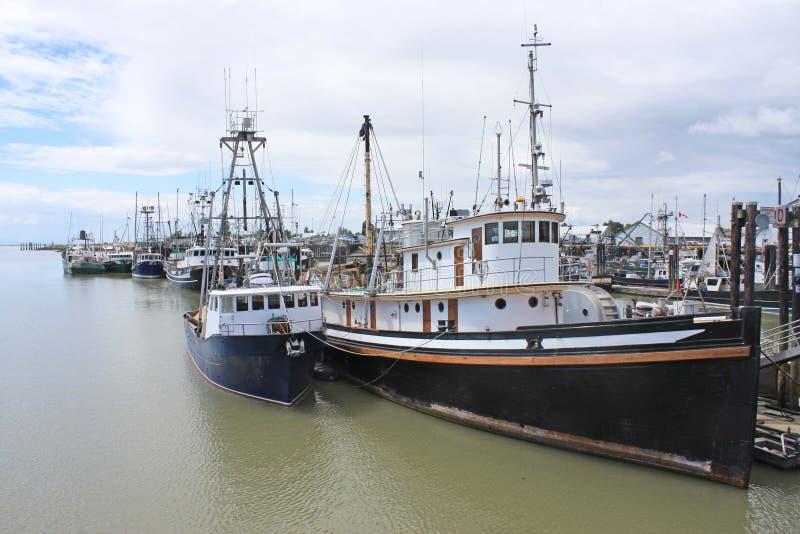 Fishing boats in Steveston Harbor, Canada. Fishing boats in Steveston Harbor, British Columbia Canada royalty free stock photos