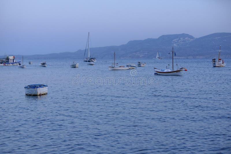 Fishing boats at sunset royalty free stock photography