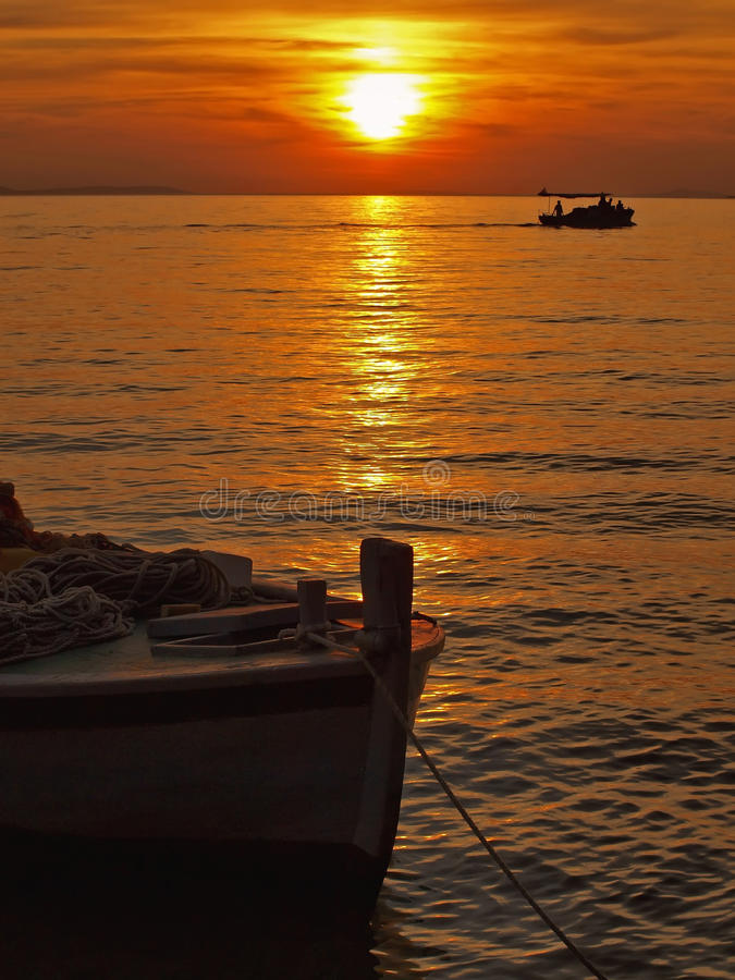 Fishing boats in susnet royalty free stock images