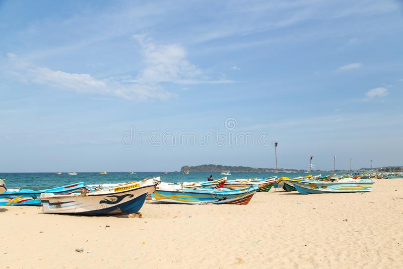 Fishing boats at Trincomalee Beach, Sri Lanka royalty free stock photos
