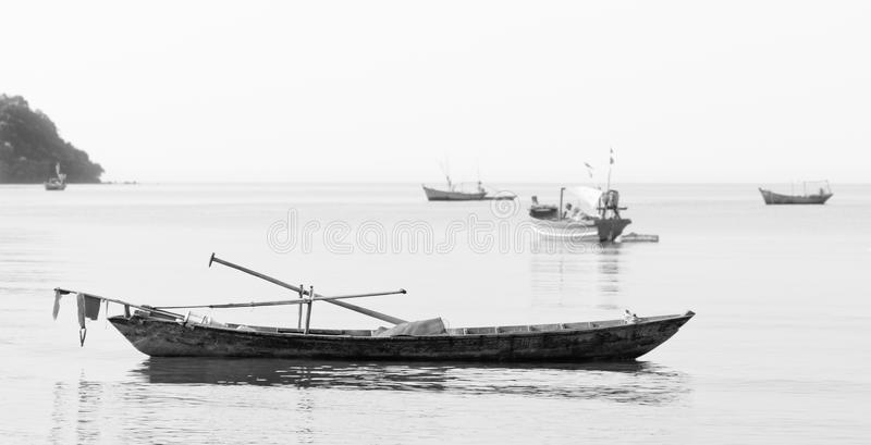 Fishing boats Vietnam. Boats at rest after an early morning of fishing, on the South China Sea, Vietnam. Black and white royalty free stock photo