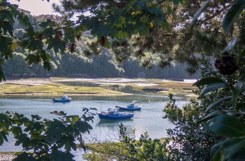 Fishing boats in the village of San Vicente de la Barquera in Cantabria, Spain.  stock image