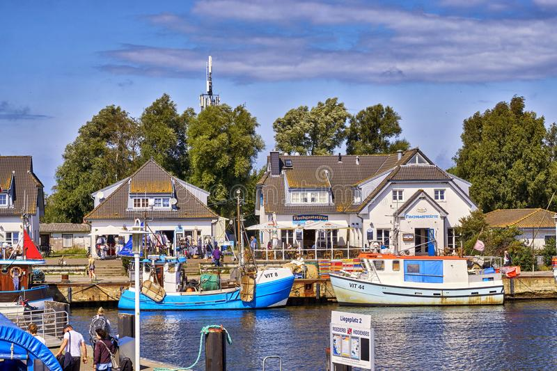 Fishing boats in Vitte at the harbor on a sunny beautiful day, Hiddensee island, Baltic Sea, Germany. Clouds, europe, port, house, mecklenburg, pomerania royalty free stock image