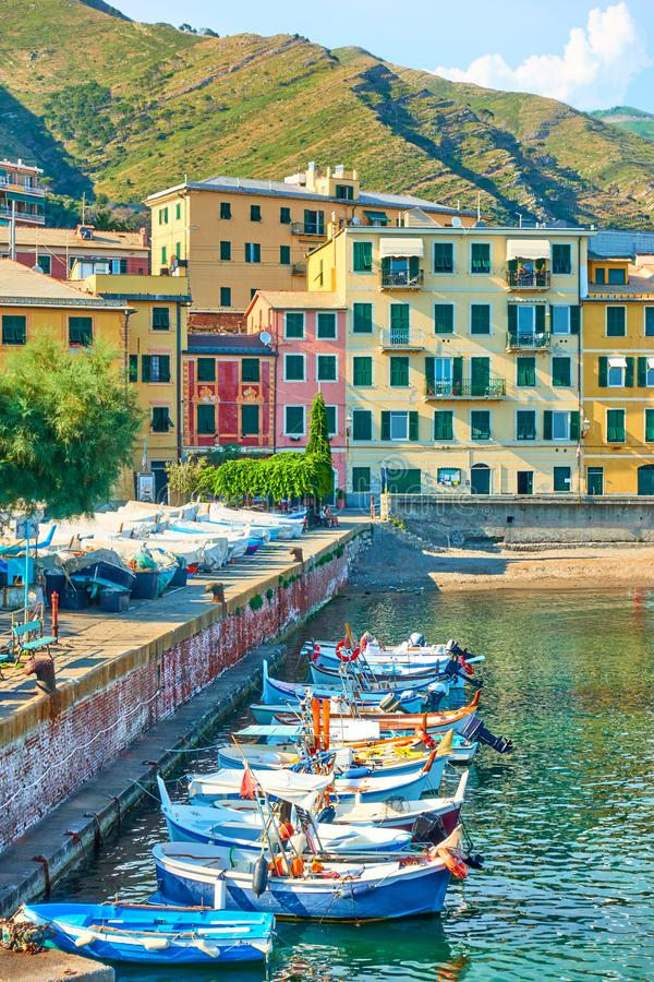 Fishing boats and waterfront in Genoa Nervi. Fishing boats and waterfront with buildings by the sea in Genoa Nervi in the summer evening stock photography