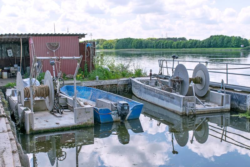 Fishing boats with winches on the Kiel Canal at the height of the fish restaurant Aalkate near royalty free stock images