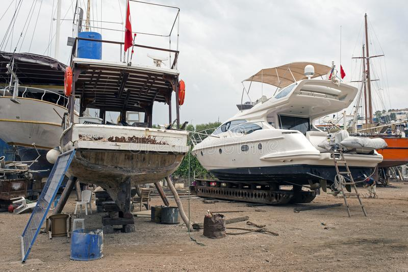 Fishing boats, wooden boats and ships on the lift in a shipyard in Bodrum, Turkey stock photo