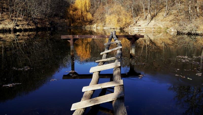 Fishing bridge by the lake stock photos