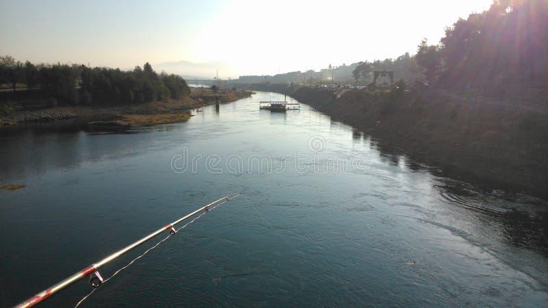 Fishing on a bridge stock images