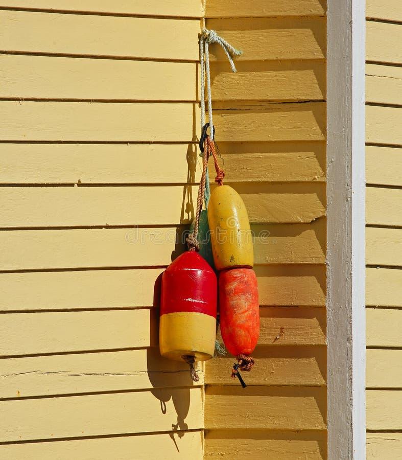Free Fishing Buoys House Shingles Yellow Royalty Free Stock Photos - 57793718