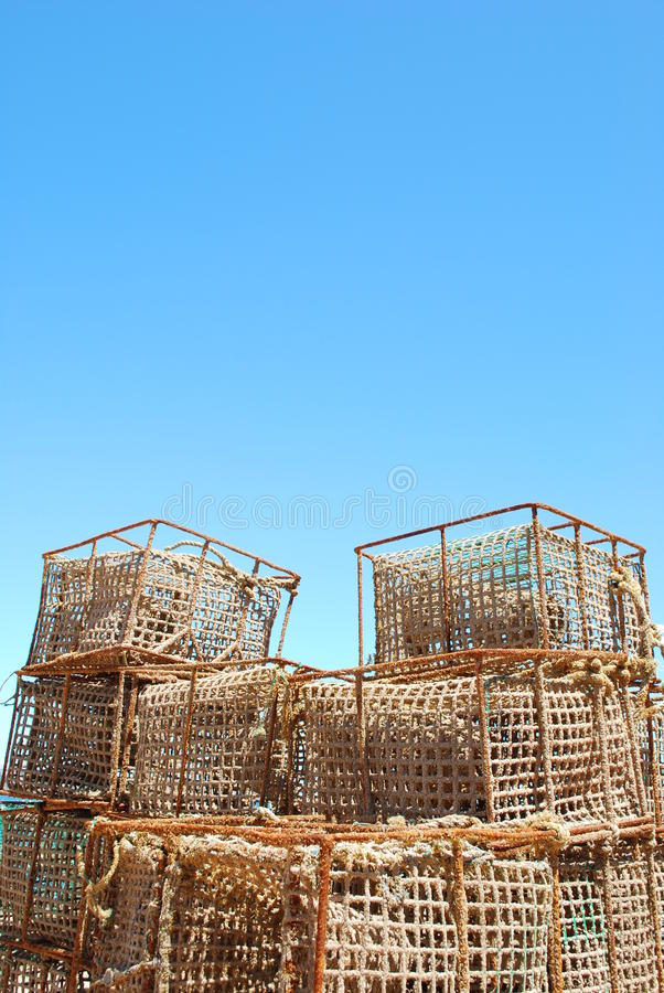 Fishing cages. Background of fishing cages in the port of Cascais, Portugal (sky background royalty free stock images