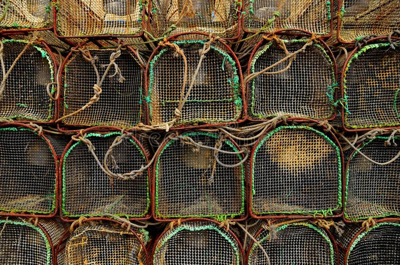 Fishing cages. Stacked, old and rusty royalty free stock photos