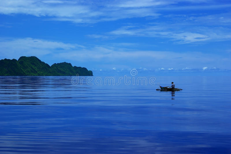 Fishing on a calm blue day