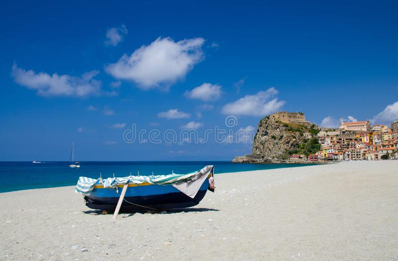 Fishing colorful boats on sandy beach, Scilla, Calabria, Italy stock photography