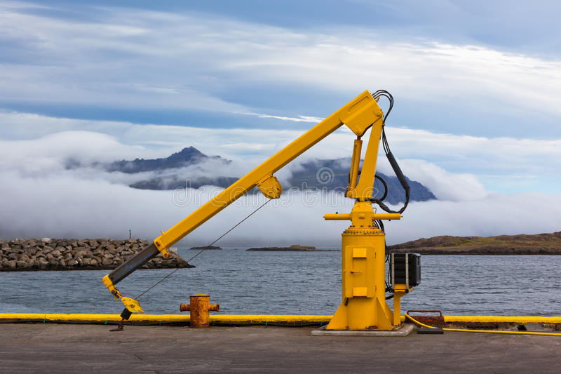 Fishing Crane In Small Seaside Iceland Town Harbor. Stock Photography
