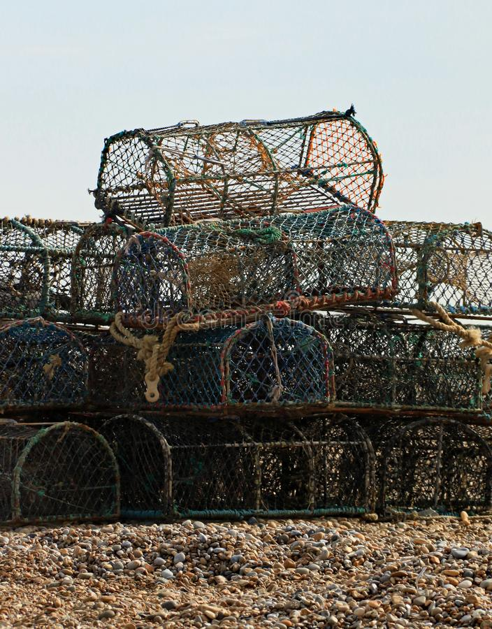 Fishing crates. Used to catch crabs on the shingle beach. The crates are taken out by fishermen and left on the seabed to catch their prey royalty free stock photo