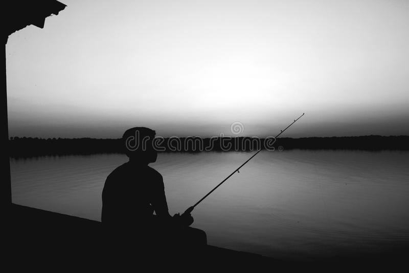 Fishing in the dark royalty free stock photography