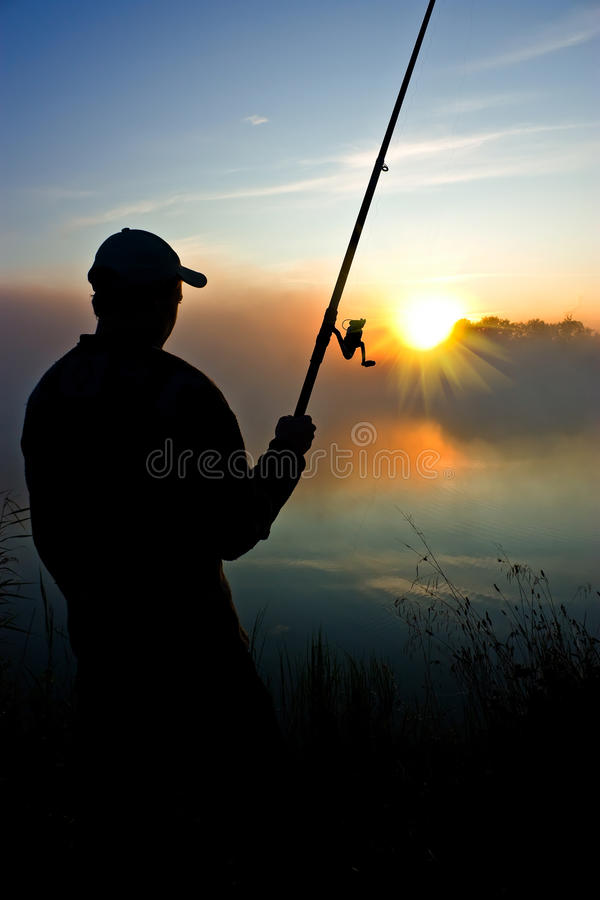 Fishing in the early morning. Fishing early in the morning, on blossoming, on a photo the photographer stock photo