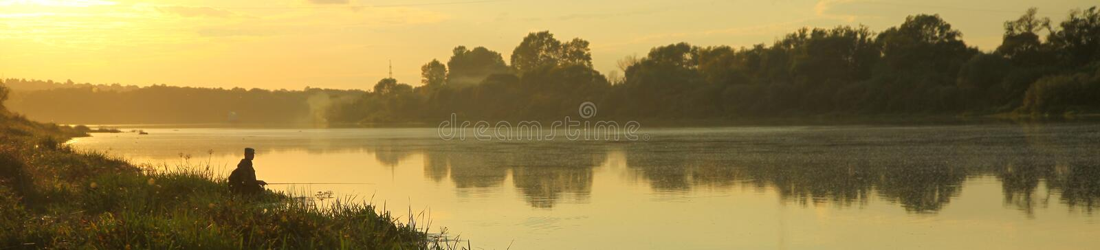 Fishing early in the morning. stock images