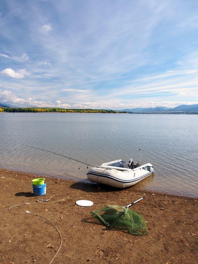 Fishing equipment and boat at Liptovska Mara stock images