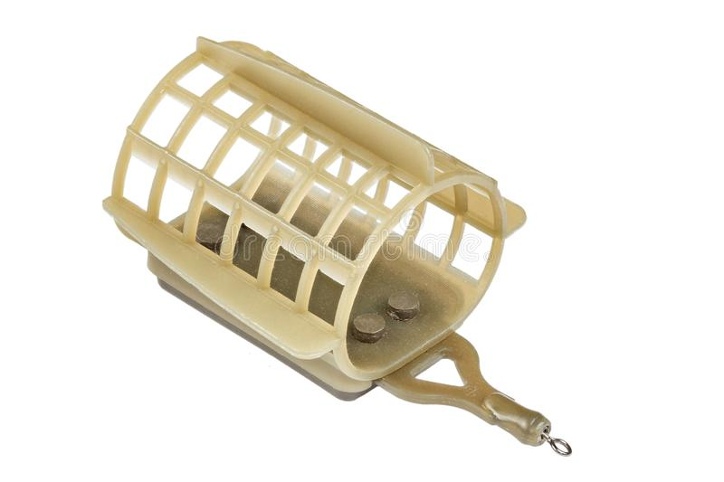 Fishing equipment. brown feeder fishing flat on a white background. File contains clipping path royalty free stock photo