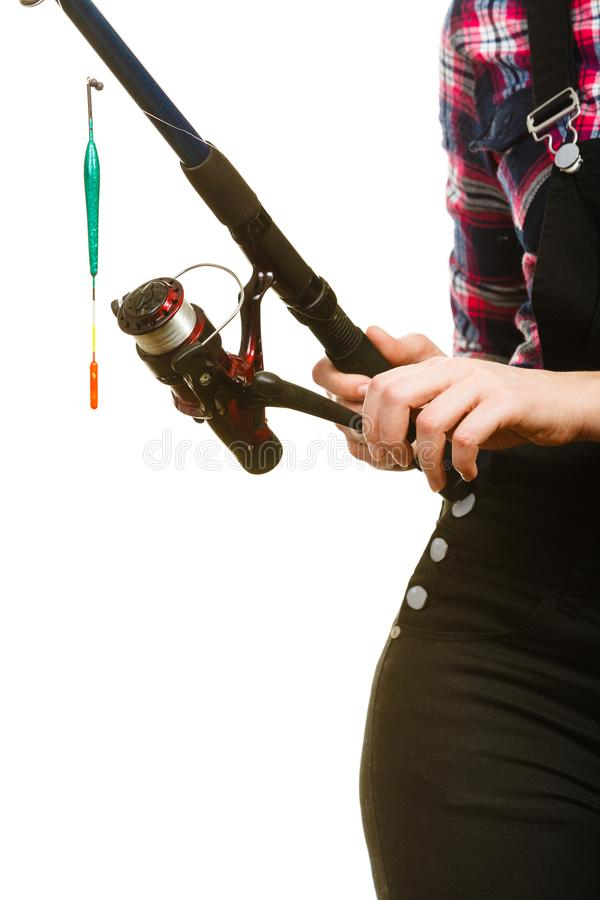 Woman holding fishing rod with float royalty free stock photo