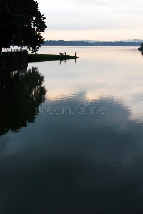 Fishing At Evening Royalty Free Stock Photo
