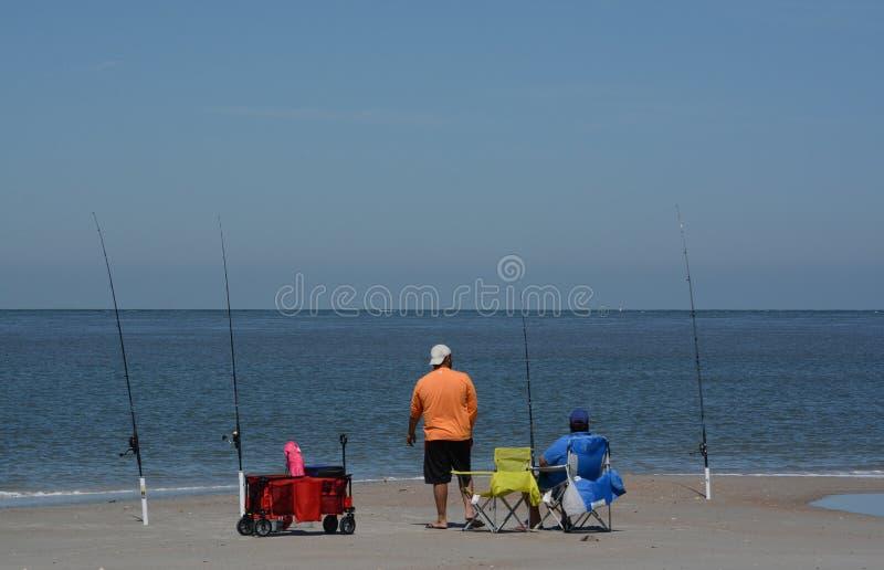 Fishing on Fernandina Beach, Cumberland Sound, Fort Clinch State Park, Nassau County, Florida USA.  royalty free stock image