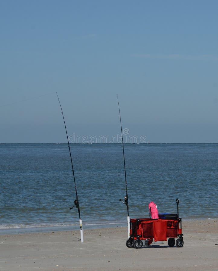 Fishing poles on Fernandina Beach, Cumberland Sound, Fort Clinch State Park, Nassau County, Florida USA. Fishing on Fernandina Beach, Cumberland Sound, Fort stock photo
