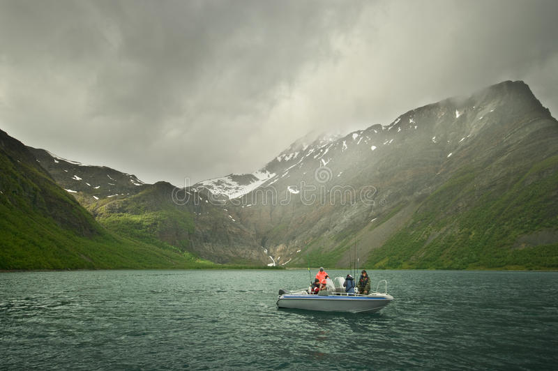 Fishing on fjord royalty free stock photos