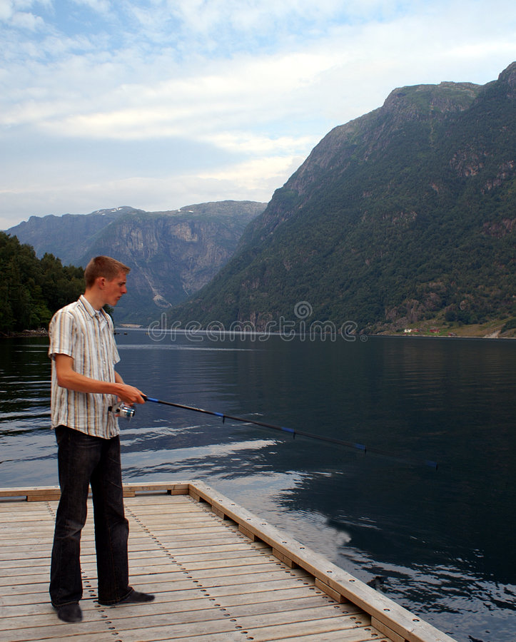 Fishing in the fjord royalty free stock images
