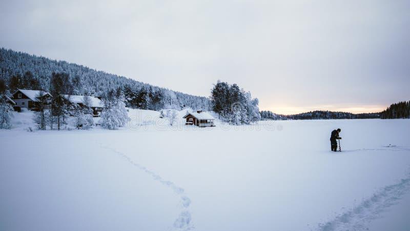 Fishing on a frozen lake. stock photo