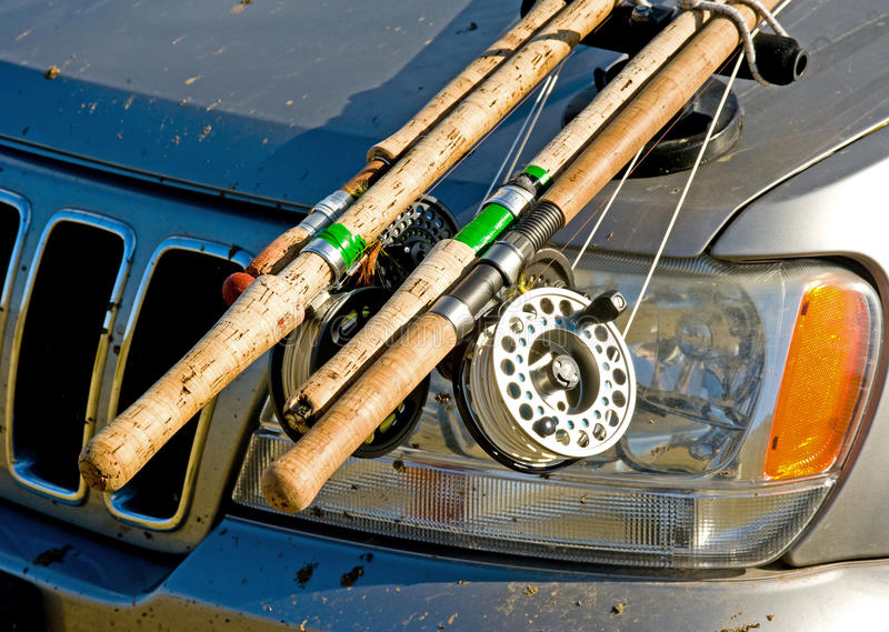 Fishing gear attached to car bonnet. An image of the working end of fishing rods attached to the bonnet of a four by four vehicle royalty free stock photography