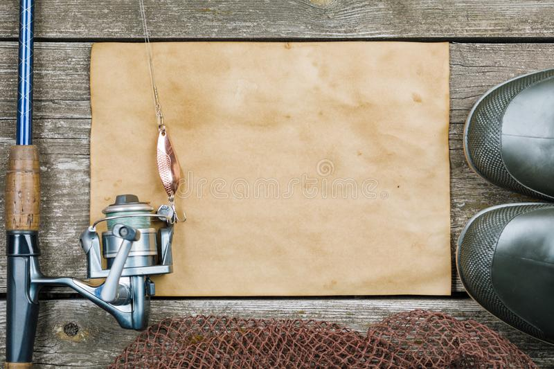 Fishing accessories on wooden background. background image.  stock photo