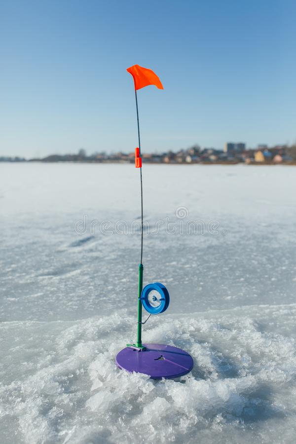 Fishing gear on a winter, snow-covered river. stock photo