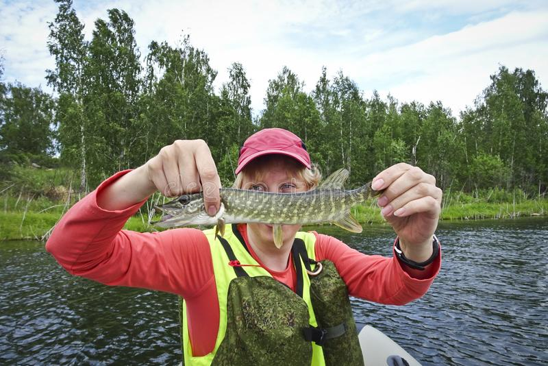 Fishing is a great catch. Caught fish in the hands of a happy fisherman stock photography