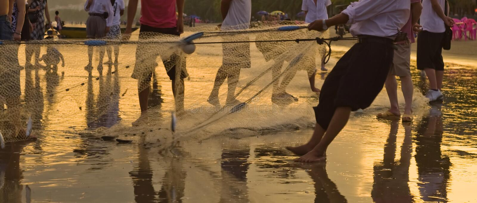Fishing with group of Hainan fishers gathering the net royalty free stock images