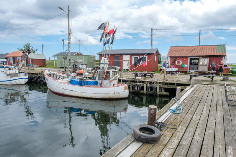 Fishing harbor in Sweden. Bläsinge, Sweden - July 12, 2017: Bläsinge harbor on the east coast of Swedish Baltic sea island Öland. Öland is a stock photo