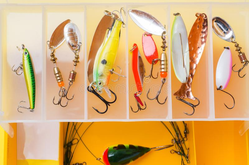 Fishing hooks and bait in a set for catching different fish.  royalty free stock photography
