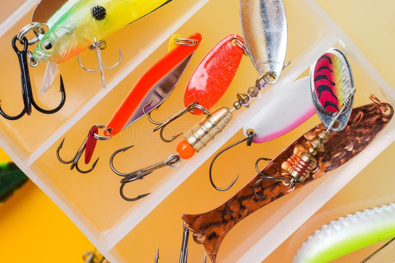 Fishing hooks and bait in a set for catching different fish.  stock image
