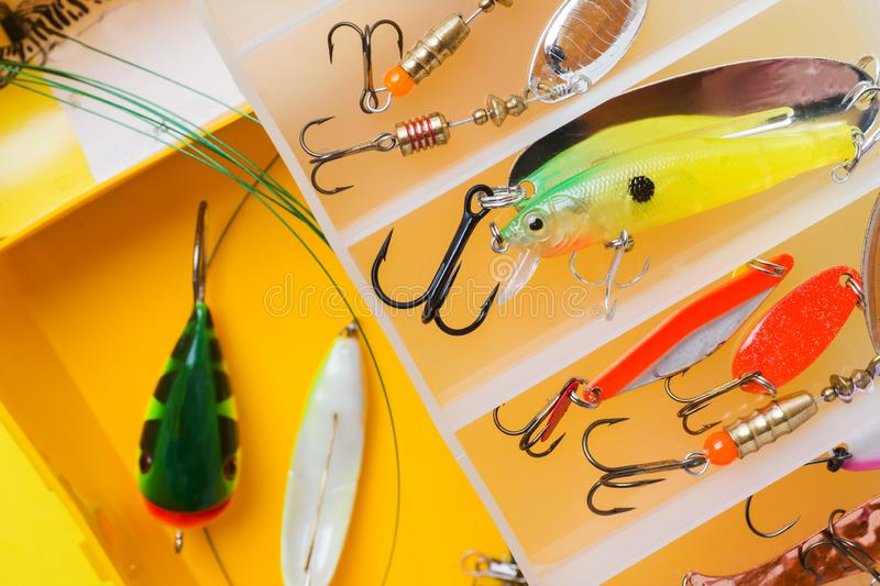 Fishing hooks and bait in a set for catching different fish.  stock photo