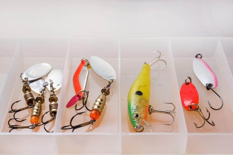 Fishing hooks and bait in a set for catching different fish.  stock images