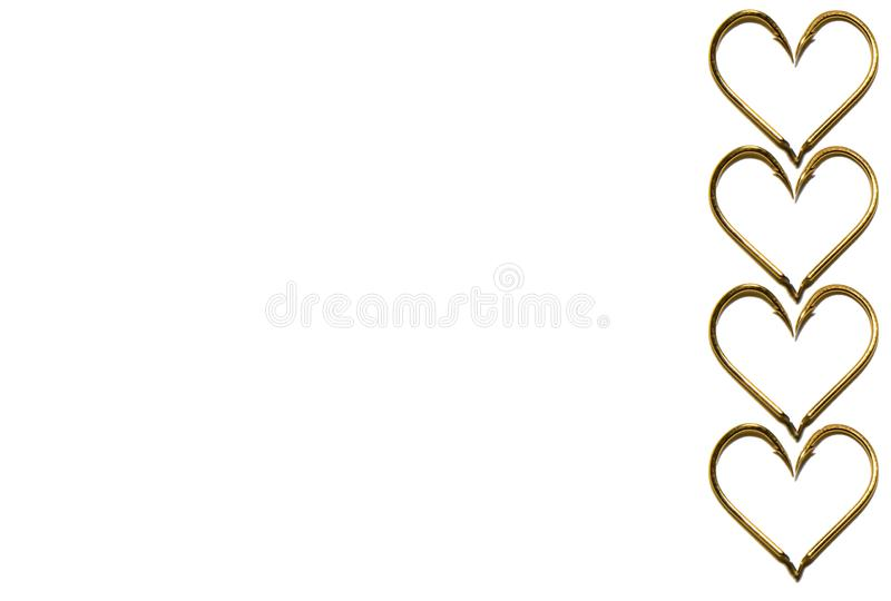 Fishing hooks in gold color. The hearts of the hooks. Abstraction. Isolated. Fishing hooks in gold color. The hearts of the hooks. Patterns of metal fishing royalty free stock images