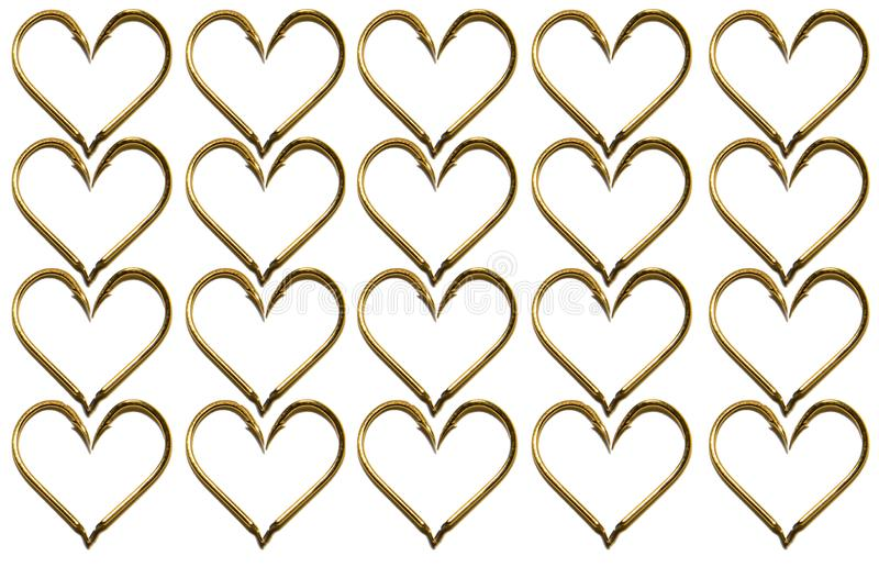 Fishing hooks in gold color. The hearts of the hooks. Abstraction. Isolated. Fishing hooks in gold color. The hearts of the hooks. Patterns of metal fishing royalty free stock photo